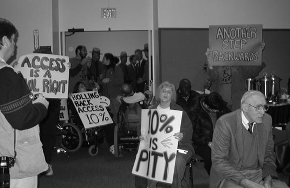 Photo of activists blocking the door at the Albany Building Codes Meeting