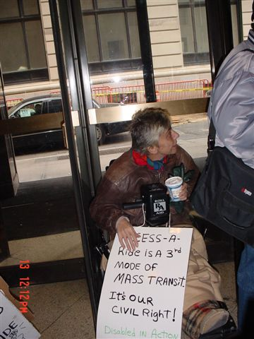 photo of the protest at the Human Rights Commission March 13, 2003
