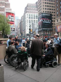 larger photo of people in wheelchairs on 34th street