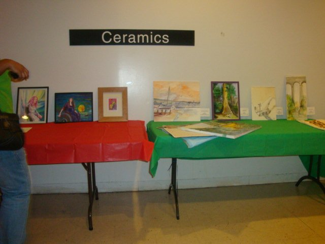 larger photo of table showing various art work by the members of Disabled In Action