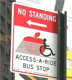Access-A-Ride Bus Stop Sign with the phrase No Standing with an arrow pointing to the left on top of sign