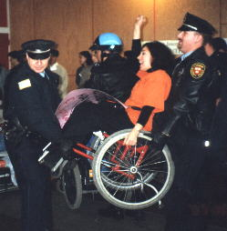 Nadina LaSpina being carried away by police