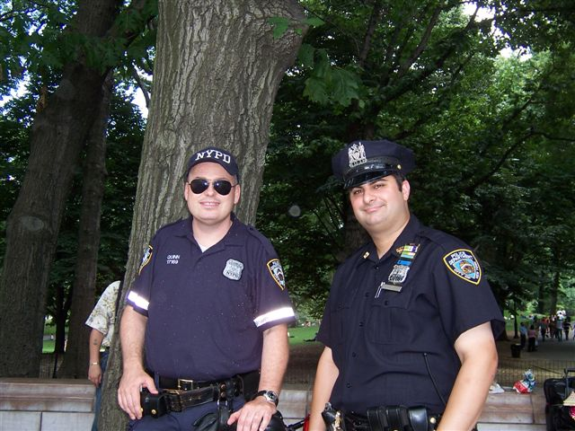 larger photo of a couple of policemen in the park during the ADA celebration