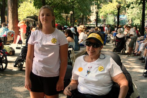 larger photo of Eva standing next to Disabled In Action member Jean Ryan