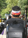 photo of the back view of person's head wearing a sign proclaiming the ADA