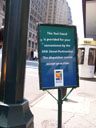 photo of sign on sidewalk in front of Penn Station taxi stand