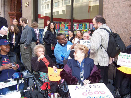 larger photo of Disabled In Activists waiting for the start of the press conference