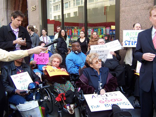 larger photo of some Disabled In Action activists at the press conference