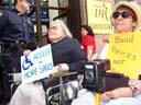 photo of Disabled In Activists carrying signs
