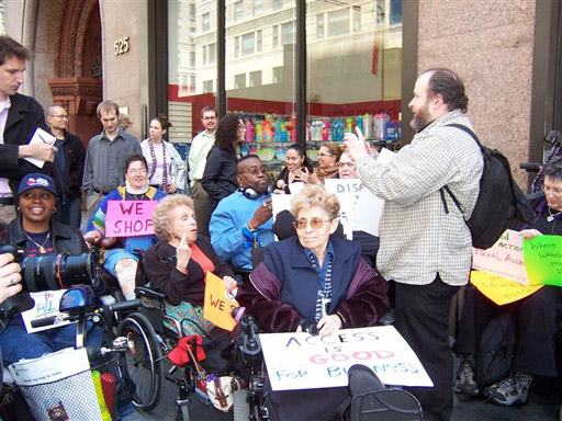 larger photo of Disabled In Action activists gathering for the press conference