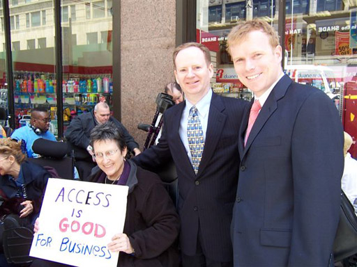 larger photo of Jean Ryan and two of the lawyers representing Disabled In Action
