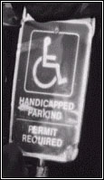Street sign reading Handicapped parking permit required