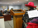 photo of closer view of Jean Ryan speaking at a podium at TLC hearing