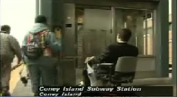 Picture from News 12 Brooklyn of Michael Harris and his scooter at the elevator at Stillwell Avenue subway station