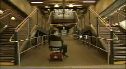 Picture from News 12 Brooklyn of Michael Harris and his scooter on the ramp at Stillwell Avenue subway station