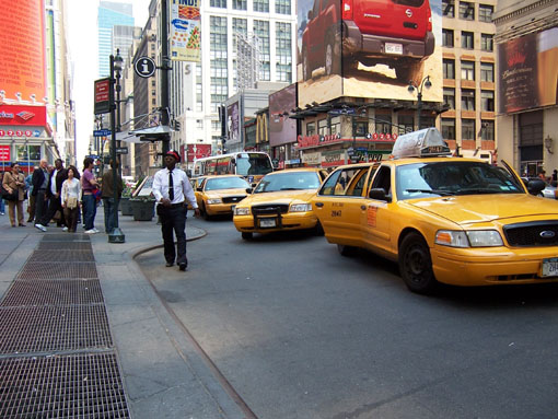 larger photo of a row of inaccessible New York City cabs