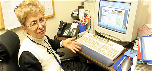 Luda Demikhovskaya sitting at her desk in her office at ICD in Manhattan