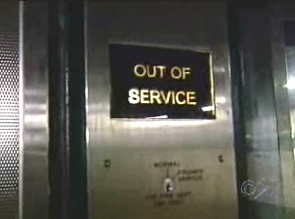 Picture from WCBS TV of Out of Service sign at a subway station elevator