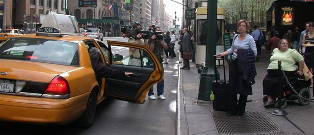 larger photo of cameramen filming the taxi line in front of Penn Station